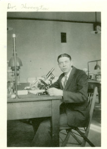 H. D. Harrington at microscope