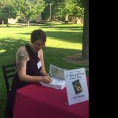 Jennifer Ackerfield autographs a book for her fans