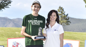 Cross Country racer Jerrell Mock accepts the trophy for 2015 Mountain West Individual Title.  Photo by CSU Athletics